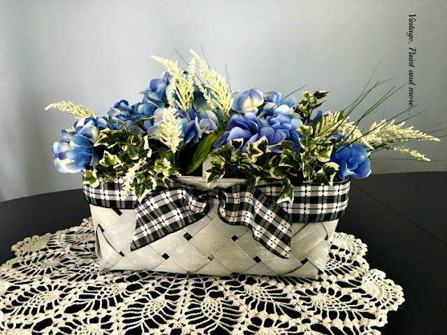 faux vintage market basket with black check ribbon and blue hydrngeas