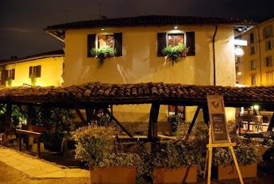El Brellin Restaurant for aperitivo exterior next to rustic laundry washing alley in Navigli Milan Vicolo dei Lavandai