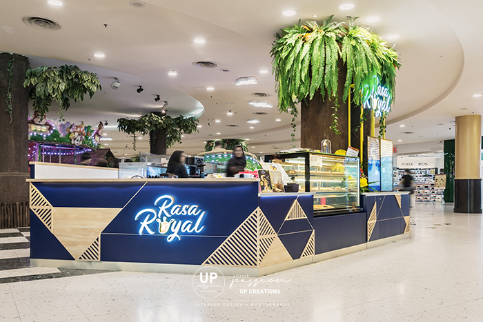 Sunway pyramid rasa royal kiosk in royal blue color and mid tone wood texture for an outstanding corporate identity