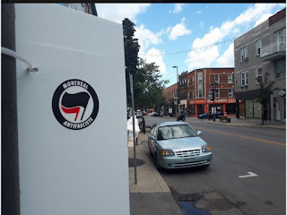 Members of Montréal Antifasciste roamed Ontario St. Sunday removing stickers from the extreme right-wing group Atalante Québec and replacing them with their own.