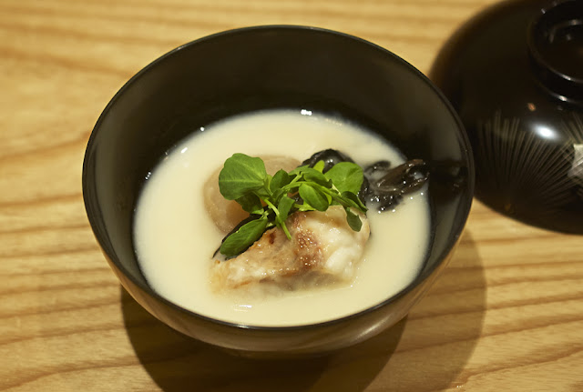 Sake Paste Soup (Kasujiru) with turnip, black trumpet mushrooms, kelp bass and watercress. photo by NAOKO TAKAGI