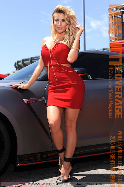 Wheels and Heels Magazine Cover Model Jessica Weaver in red dress at 2015 Nitto Tire Auto Enthusiast Day