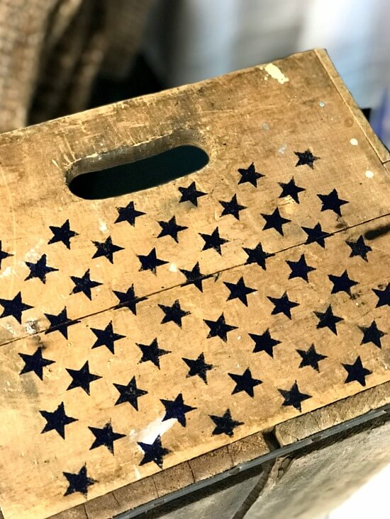 Star stencils on an antique crate