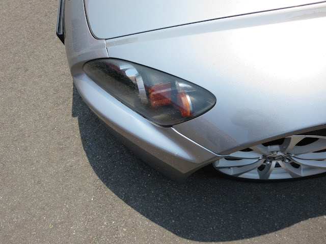 Close up of alignment problems on bumper and fender after accident.