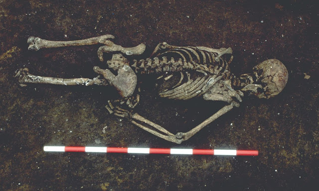1,600 year old skeleton of man whose tongue was replaced with a stone discovered in UK