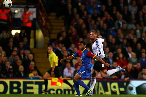 Fulham player Pajtim Kasami scores his team's first goal against Crystal Palace