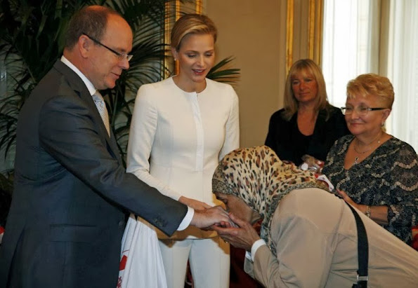 Prince Albert and Princess Charlene attended the Monaco Red Cross gifts distribution as part of the National Day ceremonies in Monte-Carlo