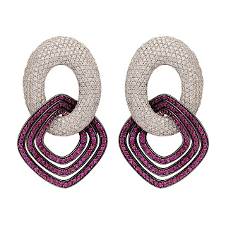 Elegant Earrings curated in 18 K Gold finished in black polish and set with Rubies and Diamonds in an invisible setting by Tanya Rastogi