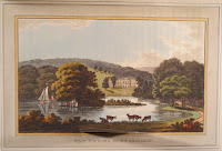 A landscape featuring cows, a lake, and a distant manor house.