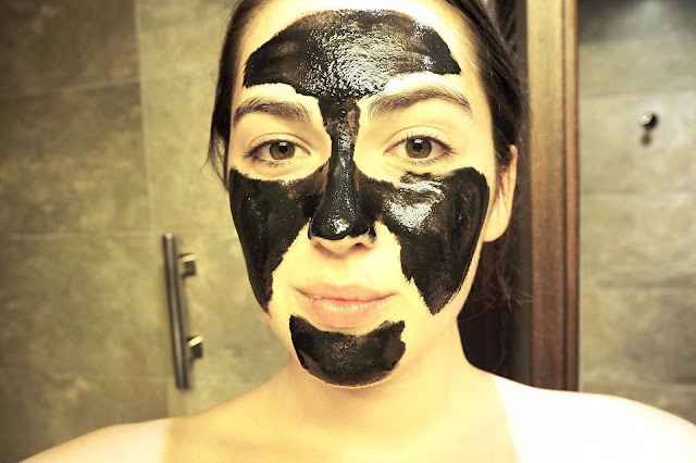 Applying peel off face mask