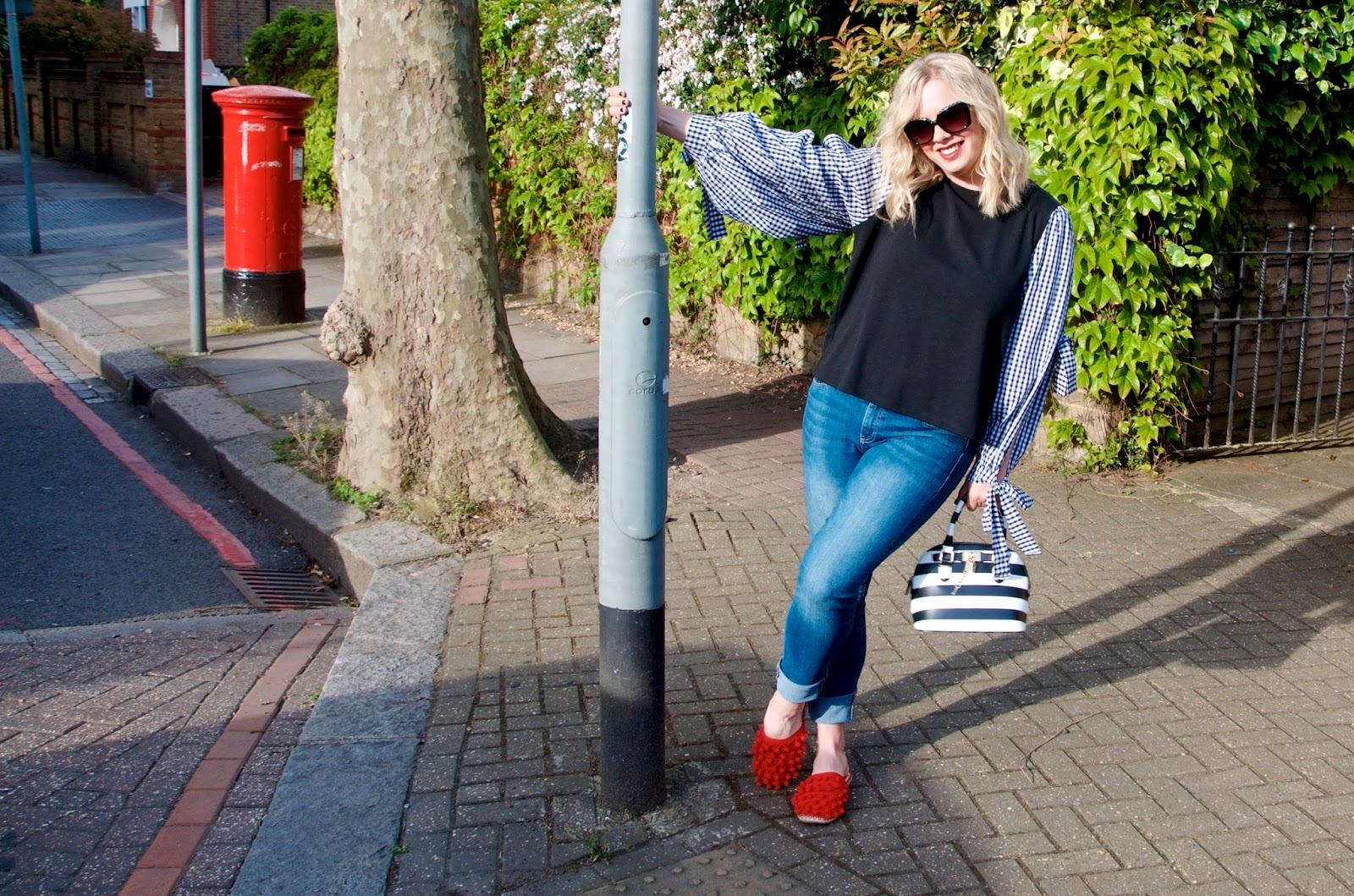 red mailbox and swinging on a lamp post