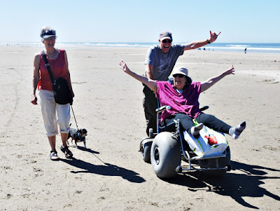Terri on beach wheelchair
