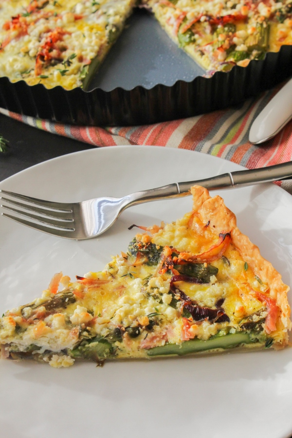 This Rustic Ham, Asparagus and Goat Cheese Tart is flaky and delicious and will be the star of your spring brunch menu!