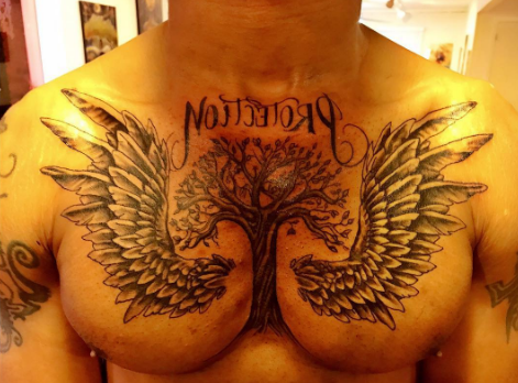 Welcome to dotun david 39 s blog singer morachi shows off for Cut off tattoo