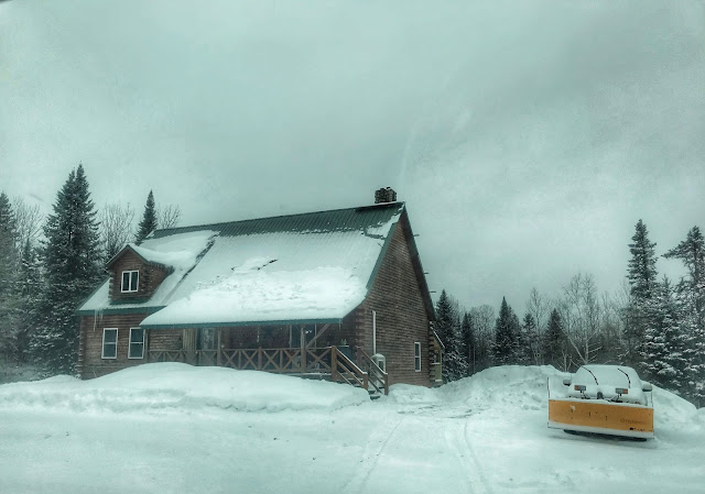 our log home slowly getting buried in snow in Maine