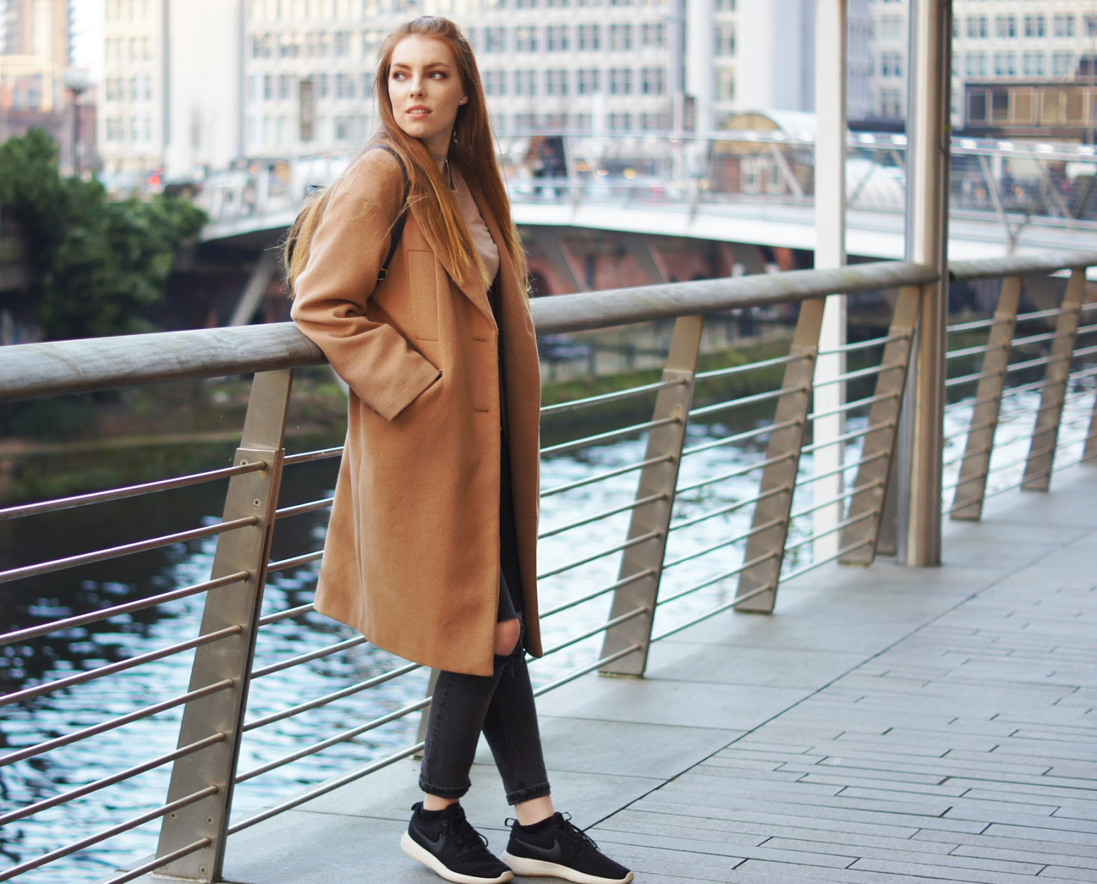 long coat and trainers