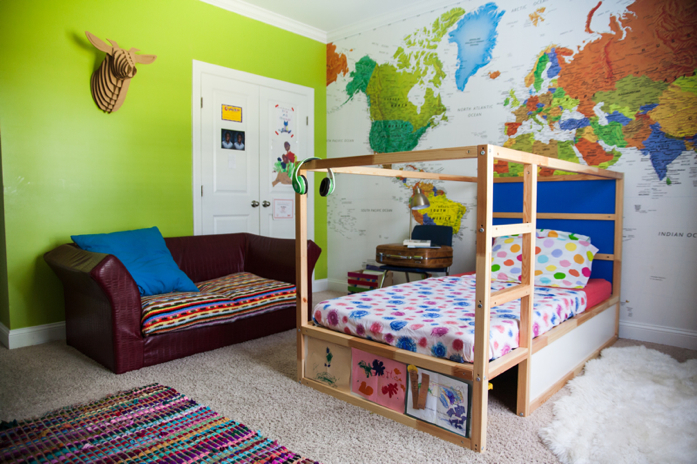 Kid's colorful bedroom with huge map wall.