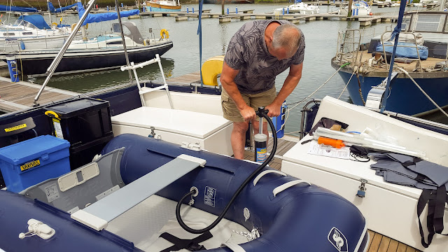 Photo of blowing up the new dinghy on Ravensdale's aft deck
