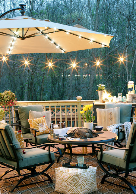 How to illuminate a backyard deck with string lights and lighted umbrella.