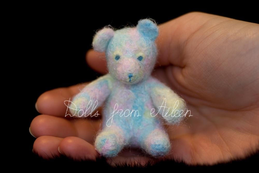 OOAK needle felted rainbow teddy bear on human hand