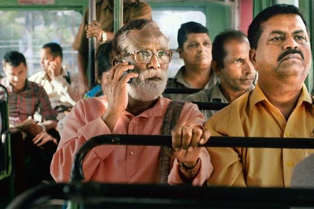 Narayan Kamble travels in a public bus, attends his cellphone, in Court, Directed by Chaitanya Tamhane