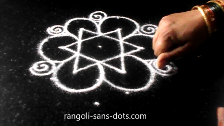 dotted-rangoli-in-black-background-272ac.jpg