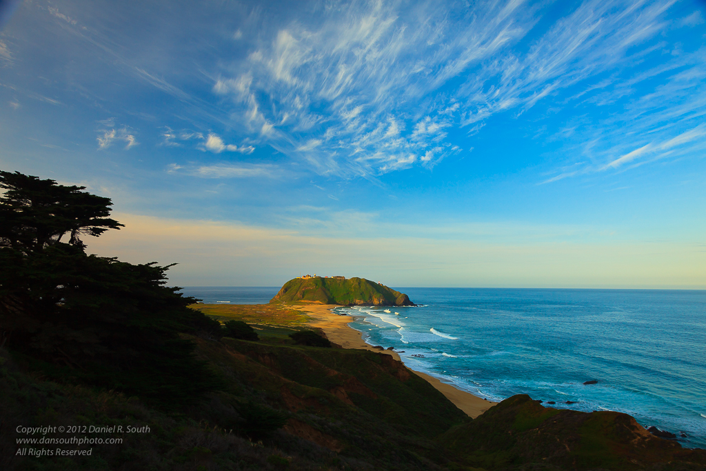 a photo of the point sur lighthouse at sunrise