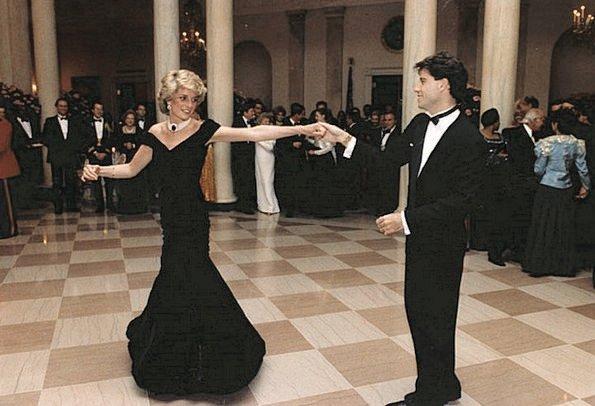 Princess Diana dances with John Travolta, Nancy Davis Reagan, Ronald Reagan. Princess Diana visit Italy  wore Emanuel blue tartan suit. blue velvet Victor Edelstein evening gown at Whitehouse
