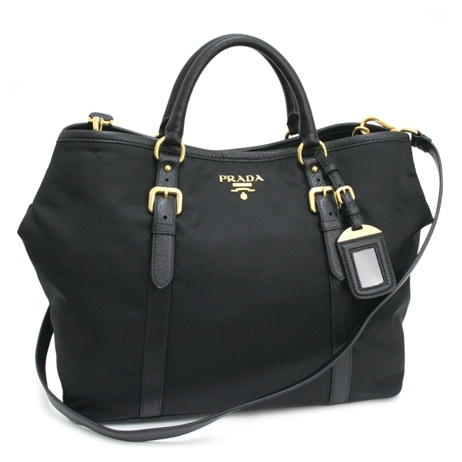 20a3c42dce68 Signature Nylon in gold-plated hardware * Inside zip pocket & multifunction  pockets * Snap closure * Dual handle with 5