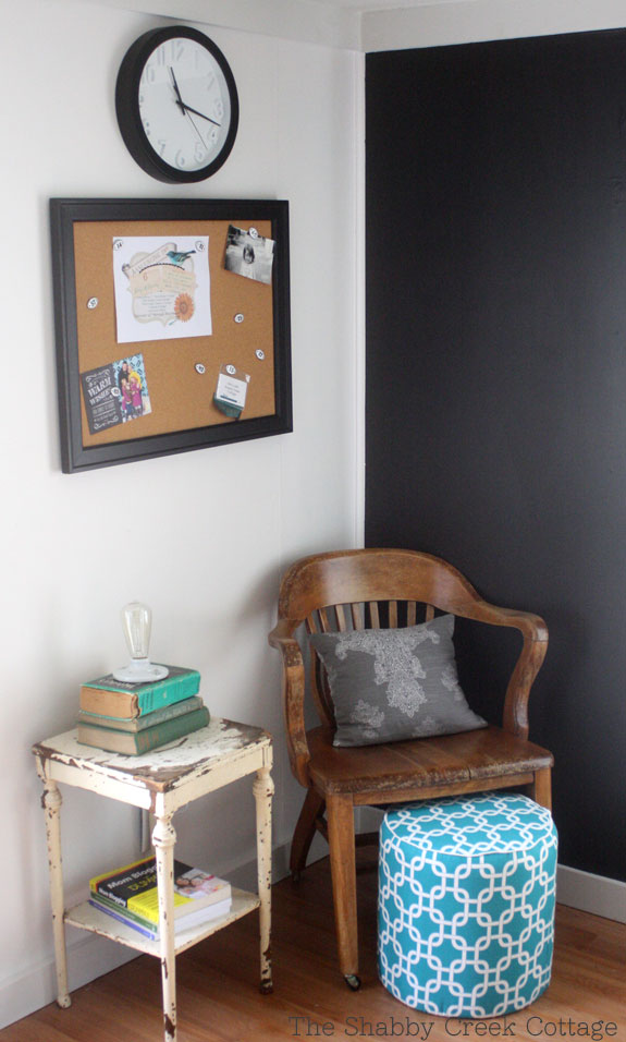 This DIY ottoman is a great accent piece in an office or living room