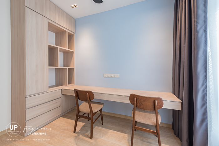 royal regent condo study room in light blue color paint with wood texture book shelf and study table