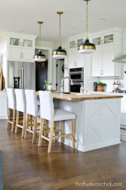 Light gray island white cabinets kitchen