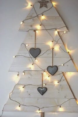http://carlaaston.com/designed/25-extraordinary-christmas-tree-designs