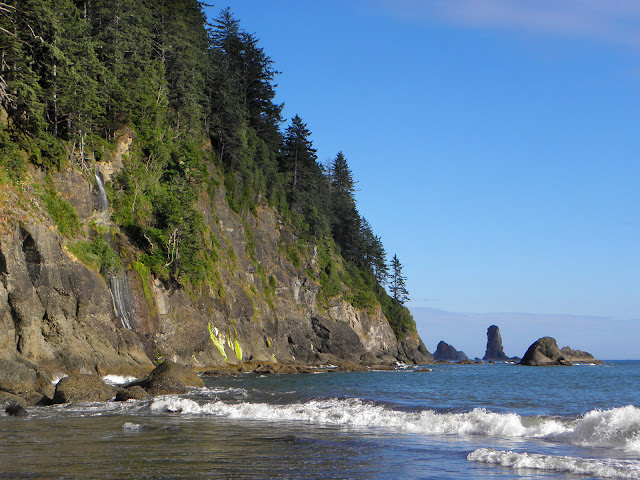 Tiny Strawberry falls on left, Rocky point on right, waves in foreground