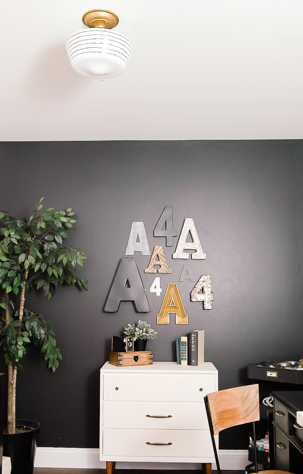 Bold office with Iron Ore wall and gold and wood accents
