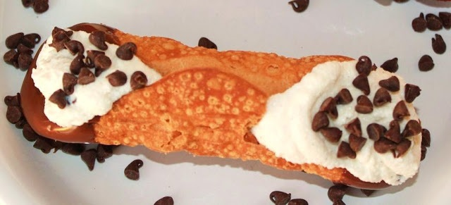 this is a cannoli filled with ricotta cheese filling and mini chocolate chips