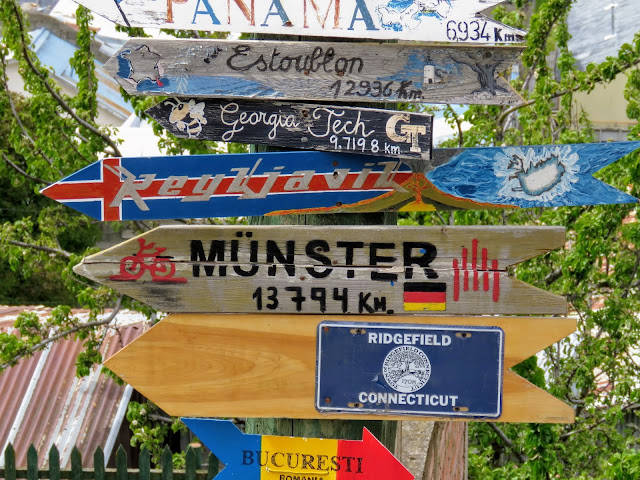Signs pointing to cities around the world at Cerro de la Cruz in Punta Arenas Chile