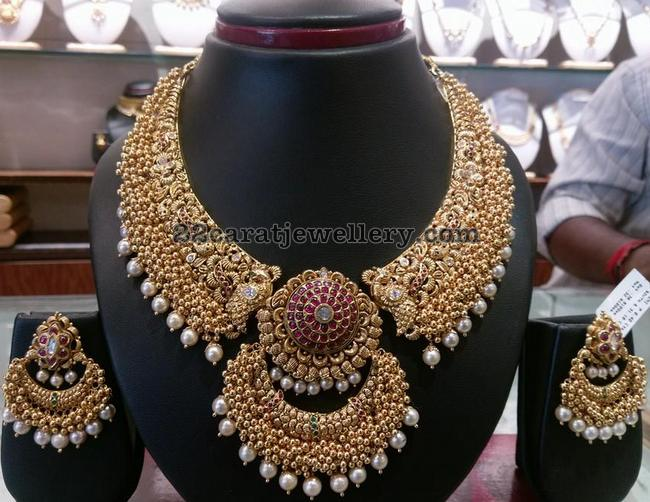 Gold Swirls Broad Necklace