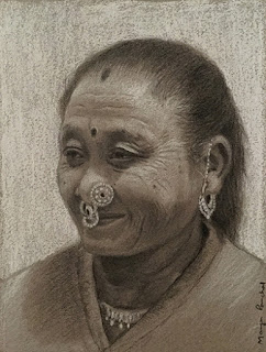 Charcoal drawing of a portrait of a woman from Sikkim on Canson Mi Teintes paper