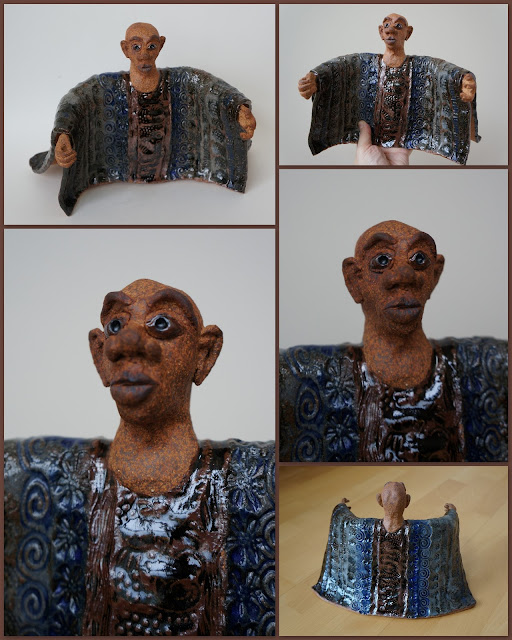 African man in colourful boubou, ceramic sculpture by Lily L.