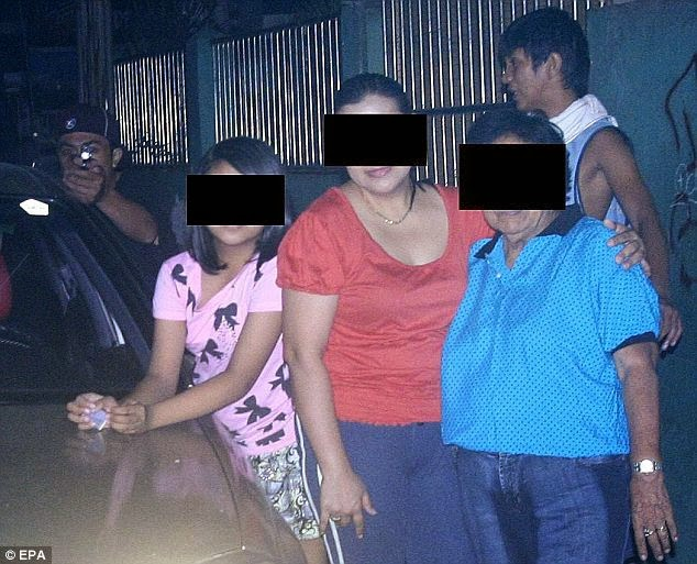 A Filipino politician took this photo of his family moments before being assassinated.