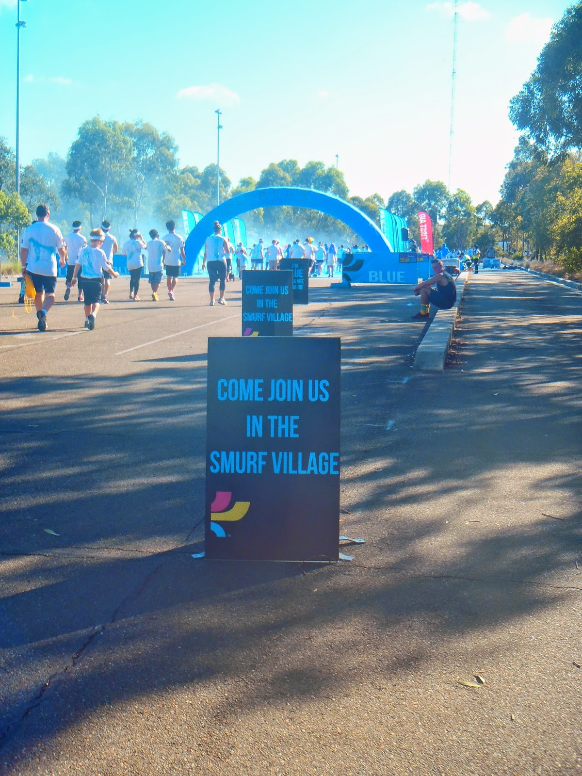 sign pointing towards smurf village