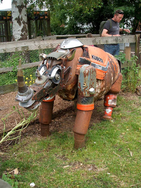 impressive recycled metal rhino art sculpture at windmill hill city farm in bristol, upcycling, eco friendly