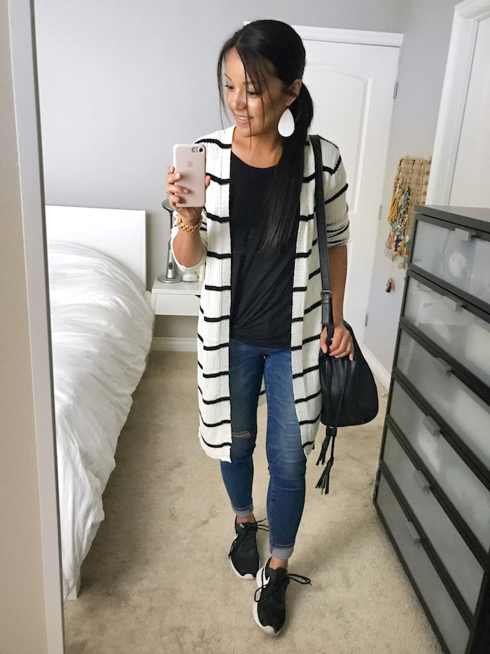 Striped sweater + black tee + distressed jeans + sneakers