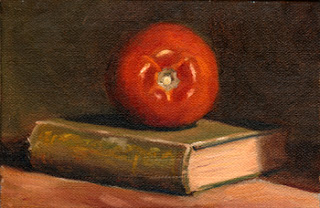 Oil painting of a red tomato on a green linen-bound book.