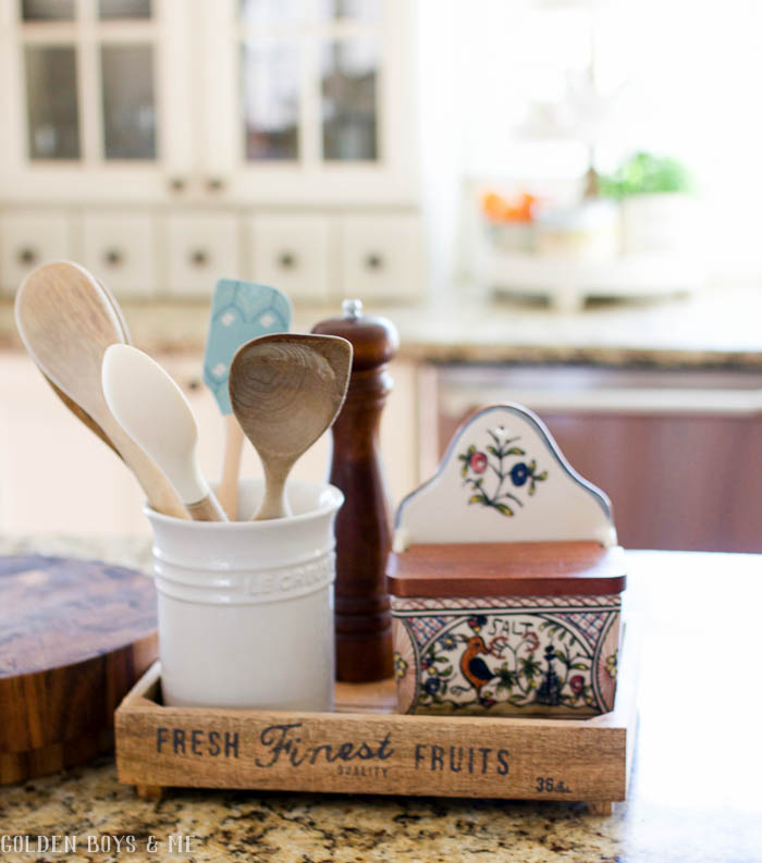 Utensils in crocks on counter in farmhouse style kitchen with Williams Sonoma salt keeper
