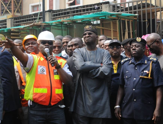 Photos: Lagos state governor, Babatunde Fashola paid a visit to the section of Balogun market that was gutted by fire