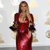 Beyonce showcases baby bump in slinky red Peter Dundas dress at Grammys