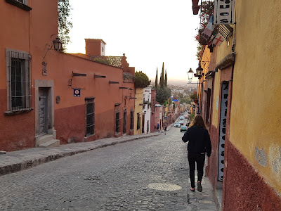 Narrow sidewalks and cobblestone streets in San Miguel de Allende.
