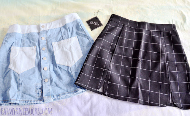 My order from Zaful contained a denim button-front skirt with rose patch embroidery and a black grid bodycon Brandy Melville Raquel dupe skirt.
